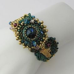 Freeform peyote bracelet, deep teal, burgandy and gold Montana Sapphire rivoli