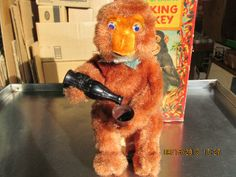 icollect247.com Online Vintage Antiques and Collectables - DRINKING MONKEY W/ LIGHTED EYES BATTERY OPERATED JAPAN BOXED