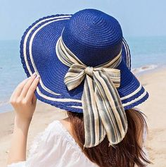 08044f4bfe1 Navy straw wide brimmed sun hat for women stylish striped bow beach hat