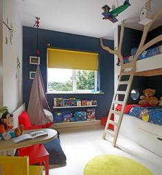 This striking navy blue wall is 12 BB 07/063 and can be mixed by your local Dulux stockist into our Easycare Diamond Matt for a tough finish for those sticky fingers. Kids bunk beds painted in white with a tree like ladder, navy blue feature wall and bright yellow accents in the chairs, rug and…