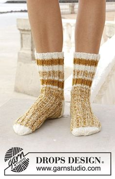 Sunny Feet - Knitted socks with stripes. Size 35-43. Piece is knitted top down with 2 strands in DROPS Fabel. Free knitted pattern DROPS 189-32