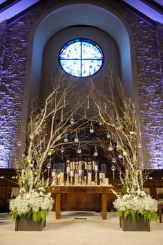 A beautiful branch alter. Flowers by Trochta's Flowers and Garden Center. Holli B. Photography. Wedding by Amanda Sikich of Planned 2 Perfection Weddings. #wedding #winter #alter #branches