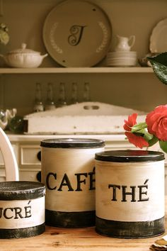 diy french canisters - now I wish I had saved all those ugly popcorn cans from years ago.