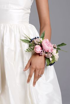 "An Unexpected Wedding Detail: Floral Bridal Corsages. If the word ""corsage"" makes you cringe with the thought of high school prom, think again. Beautiful, blooming wrist corsages are earning a place in the wedding world and we understand why: Not only are they super pretty, but corsages are also a cost-effective way to make a big statement without blowing your whole budget on flowers for you and your bridesmaids."