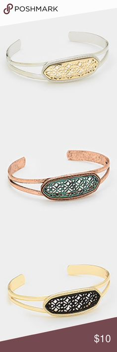 Bracelet Moroccan cuff NWT select one color Select the color of your choice. Silvertone with goldtone filigree, gold tone with black filigree and patina with rose gold filigree. When ordering please specify color Jewelry Bracelets