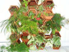 The Bali Ecological Center Creates a Modular Terracotta Green Wall with Local Craftsmen