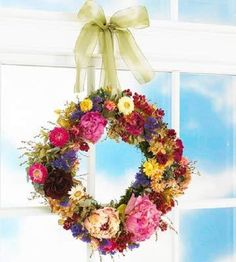 Garden wreath - Preserve your gardens' blooms with a wreath of dried botanicals. Our favorites flowers to dry include hydrangeas, peonies, roses and strawflowers.