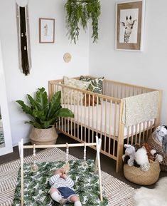 I love this very boho, africa nursery. Its very minimalist, gender neutral and has a very low key hint of safari theme. I'd like to keep all but with a surf/ hawaii element in a low key way.