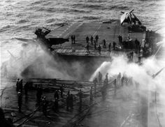 80-G-274352: USS Enterprise (CV 6) burning as a result of a Japanese suicide attack on 14 May 1945.