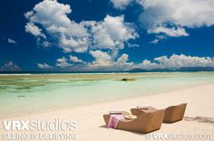 #Seychelles - Relaxing on the #beach and looking out into the crystal clear ocean waters.