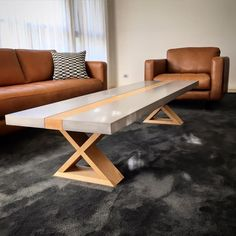Polished concrete coffee table top with timber base by Mitchell Bink Concrete Design. www.mbconcretedesign.com.au
