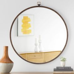 Give any space extra dimension with this classic wall mirror, featuring a round silhouette and an antiqued bronze finish. Add it to your powder room vanity for a stylish DIY update, or hang it in the entryway to complement a weathered wood storage bench.