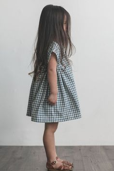 This sweet classic dress is designed to fit loosely and sit above the knee. There are three buttons at the back of the neck to allow for easy dressing. Throw on