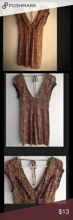 Free People top/tunic SZ M 8/10 paisley brown Pre-own Free People tunic/minidress color brown size M 8/10 it will fit a size small too, Hand Washed and flat dry, worn less than 5 times, Beautiful paisley brown print, flowy and fresh fabric, cap sleeves, double deep V neck, tides at back neck, lace details, unfinished hems,measures approximately armpit to armpit 14.5 inches shoulder to hem 29 inches  From a non-smoke non-pet home Any questions let me know  Check my closet for more Free People…