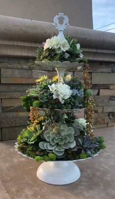 Lovely three tiered arrangement with faux succulents and florals. Accented with moss and greenery.No watering needed, just enjoy!Please read store policies before ordering. Artificial Floral Arrangements, Orchid Arrangements, Succulent Arrangements, Succulents In Containers, Cacti And Succulents, Planting Succulents, Jardin Decor, Succulent Gardening, Succulent Tree