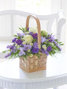The pattern in this arrangement is white roses , purple roses and also the hyacinth flowers. Basket Flower Arrangements, Beautiful Flower Arrangements, Silk Flowers, Floral Arrangements, Beautiful Flowers, Hyacinth Flowers, Rose Flowers, Easter Flowers, Spring Flowers