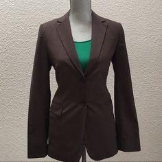 Brown Banana Republic suit blazer Brown Banana Republic blazer with two button closure. See photo for one blemish on right shoulder. Priced accordingly. Banana Republic Jackets & Coats Blazers