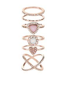 Crafted from rose gold-tone metal, this pretty six-piece styling set features an assortment of finger and midi rings. Crystal gem embellishments add delicate sparkle.