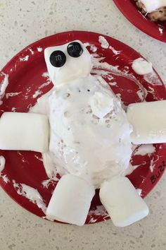 """Make your own Baymax Rice Krispie Treat! So easy and delicious!!!! Make a oval rice krispie treat and frost with """"marshmallow fluff frosting"""" and attach different marshmallow shapes."""