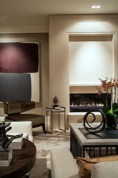 Powell and Bonnel Design Inc.  Jaw dropping art collection displayed in a clever way. Love the overall color palette.