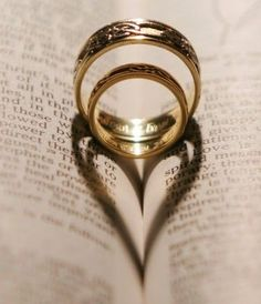 Wedding photography idea artsy Now this is what wedding rings truly represent. or just to show your love for books but then again your wedding is probably to your book(s)