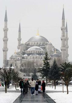 Ottoman-era Sultan Ahmed Mosque, or Blue Mosque, seen in the background, in Istanbul, Turkey,