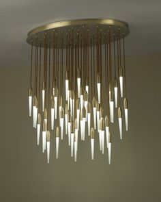 Boyd Lighting's Icicle Ellipse was designed by Tom Nahabedian. A modern take on the chandelier, this LED flush mount ceiling fixture is an arresting shower of Icicles. Nominated for a Best of Year award from Interior Design magazine, the Icicle Ellipse comes in two sizes, is available in six metal finish options, and five cord color options. Can be configured in any combination of sparkling clear glass or soft etched glass. Style: transitional, modern, luxurious, fantasy