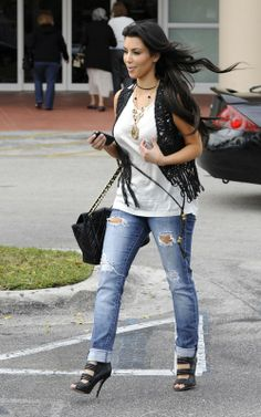 Kim Kardashian wearing Chanel Jumbo XL Quilted Flap Bag L.A.M.B. Zea Sandals in Black Vince Shell Tank AG Adriano Goldschmied Ex Boyfriend Crop Jeans Forever 21 Beaded Tribal Necklace. Kim Kardashian Shopping in Miami March 18 2010.