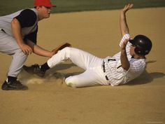 Baseball Player Sliding into a Base