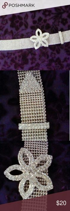 "✨ 💎SILVER BELT 💎 Silver bead mesh belt with  ✨rhinestone✨🌸 flower buckle and keeper. Belt  📐 measures 1.25"" wide, and 37.5"" long.  🌸 Flower 🌸 buckle measures 3"" diameter. This belt can  fit any size up to 36"".      💎 FLAWLESS CONDITION! 💎                  From a 🚭🆓🏡 Accessories Belts"