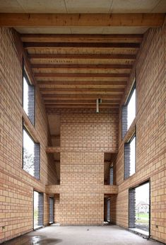 Protruding brickwork gives a ribbed facade to this family house near Brussels. Mediterranean Architecture, Brick Architecture, Contemporary Architecture, Interior Architecture, Brick Images, Arch Interior, Unusual Homes, Small Buildings, Brick And Stone