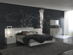 Black and white bedroom design with white wood framed bed and grey rug area
