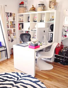 This amazing home office and dressing room!Ikea expedit desk in home office with zebra rug and panton chair