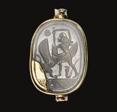 A PHOENICIAN CHALCEDONY SCARAB -  CIRCA 5TH CENTURY B.C.