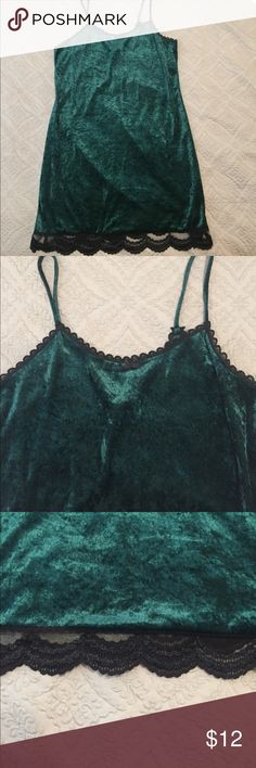 Gorgeous vintage green velvet nightgown/slipdress This vintage item is beautiful! Emerald green velvet with black lace trim and spaghetti straps! I found at a vintage store but never ended up wearing because it was a bit small. Could be worn as a nightie or sexy slip dress! Size L, can fit M, EUC! Dresses
