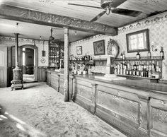 "New Orleans circa 1906. ""Old Absinthe House -- the bar."" No obvious patrons except for a number of barflies. Detroit Publishing glass negative."