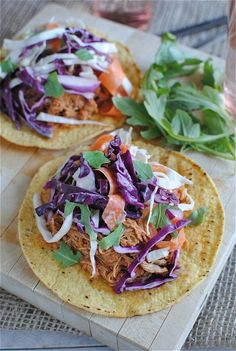 Slow Cooker Barbecue Chicken Tostadas with Cole Slaw from Bev Cooks; using the slow cooker for the chicken won't heat up the house, and the slaw provides a cooling touch, making this perfect for a #SlowCookerSummerDinner! [Featured on SlowCookerFromScratch.com]