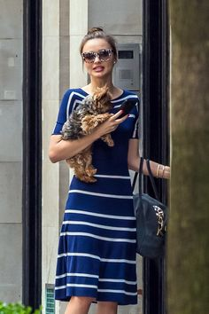 Miranda Kerr took her dog for a walk looking a little too stylish in a striped blue dress.