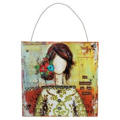 Hanging collage-style wall art with an abstract image of a woman.     Product: Wall artConstruction Material: Wood and...