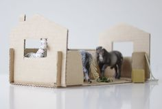 A cardboard stable