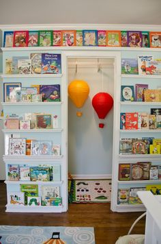 LOVE the idea of displaying books - great decor and color, and much handier than hiding them on a book shelf.