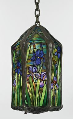 "Tiffany Studios ""IRIS"" LANTERN, leaded glass and patinated bronze 22 in. cm) height of lantern 13 in. cm) diameter 74 in. cm) maximum drop circa Estimate — Lot Sold 19 May 2015"