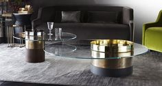 Haumea, coffee table, glass top and brass, hand burnished brass, rust and wooden layer open pore, base.