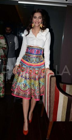 Sonam Kapoor in a statement skirt and plain white shirt. Indian fashion.