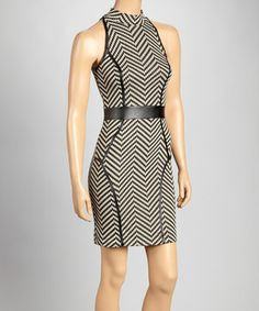 With a waist-slimming band, curve-tracing seams and a hint of stretch, this dress masters the art of figure flattery. The chic chevron print secures its place as a year-round wardrobe winner. Size note: This item runs small. The vendor recommends ordering one size up.