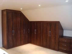 Google Image Result for http://www.customworldbedrooms.co.uk/images/wardrobes-in-walnut-with-sloping-ceiling.jpg