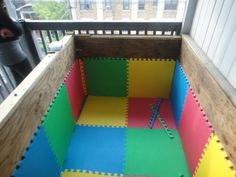 Pad your wooden box with interlocking foam pads (DIY ball pit) another good idea