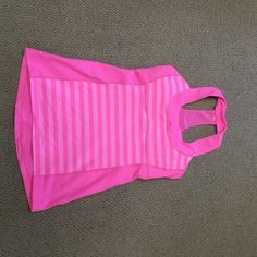 Brand new Lululemon scoop neck top. Super cute hot pink!!!! Scoop neck. Never worn!  I ordered an 8 by accident. I planned to exchange it for a 6 but, I never got around to it. lululemon athletica Tops Tank Tops