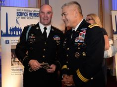 Before being recognized as the 2014 Army Times Soldier of the Year, Sgt. Thomas Block shares a laugh with Army Vice Chief of Staff Gen. John F. Campbell.