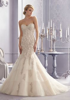 Metallic embroidery and intricate beading accent this stunning Bridal Dress. Layers of net and a sweetheart neckline evoke romantic vintage glamour.